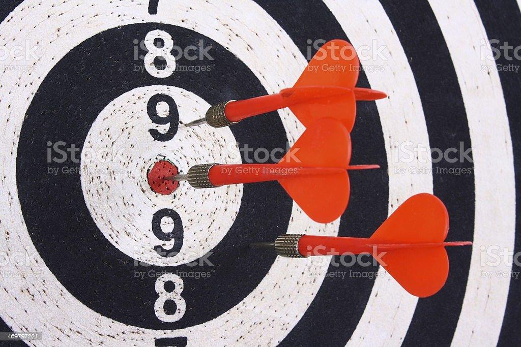 Darts and dartboard stock photo