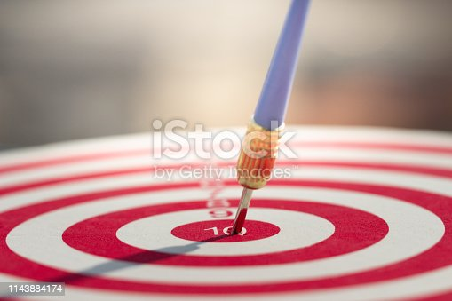 istock Darts arrow hitting in the target center of dartboard. concept business goal to marketing success. 1143884174