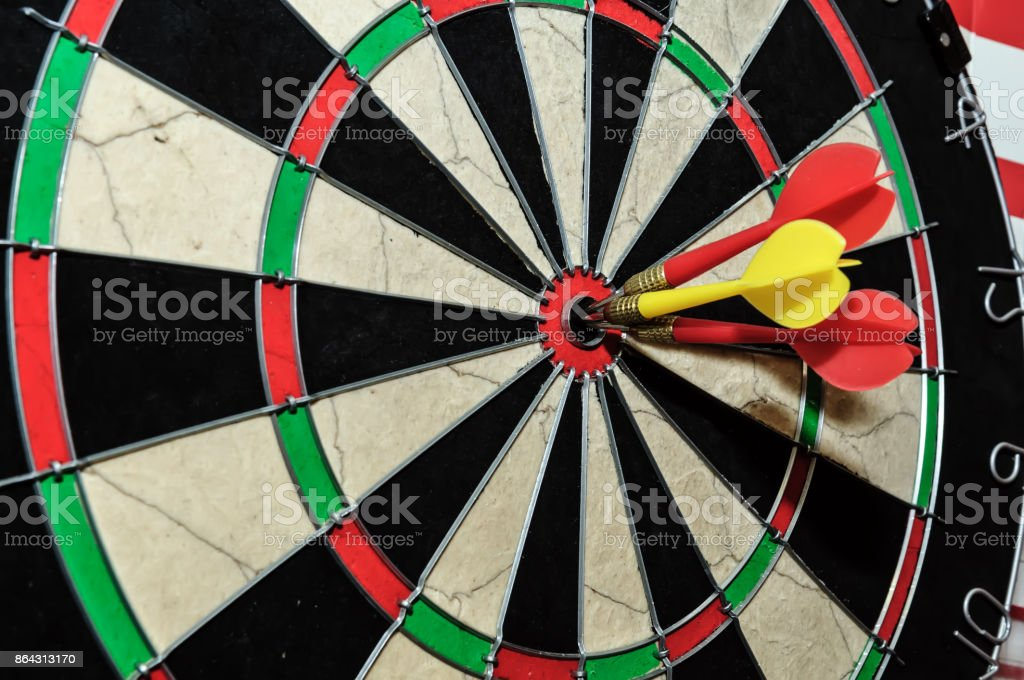darts arrows  in bull's eye stock photo