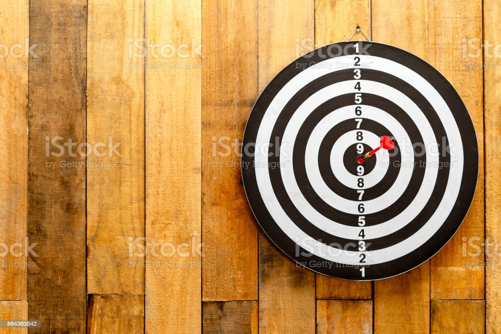 Darts board on wooden background, Darts hitting in the target,...