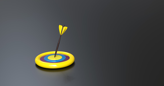 921518946 istock photo Darts hitting in the target center with copy space for your text 1226442133