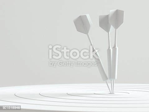 921518946istockphoto Darts hitting in the target center with copy space for your text 921518946