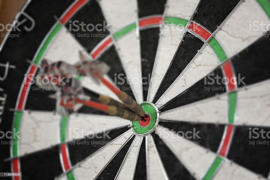 Darts in bulls eye royalty-free stock photo