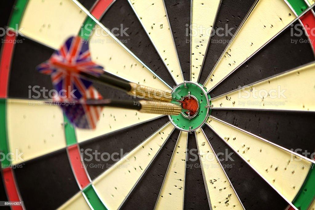 Darts in bull's eye royalty-free stock photo