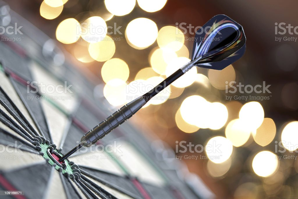 Darts in bull's-eye stock photo
