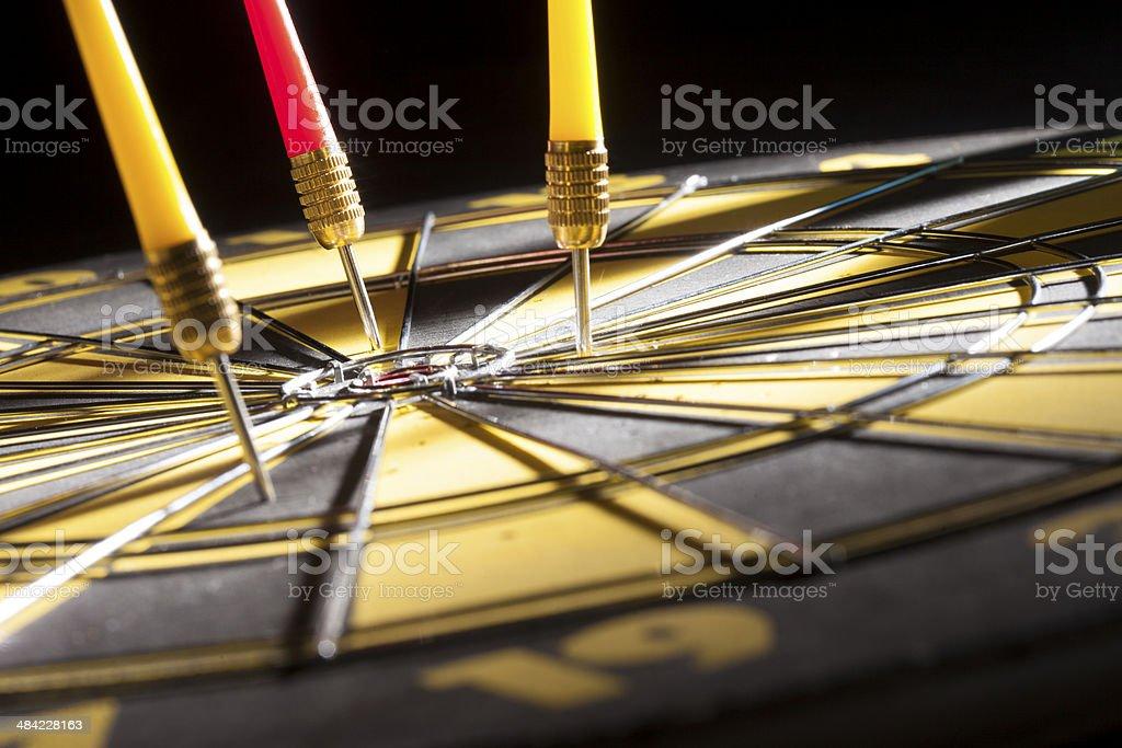 darts missing off bull's-eye stock photo