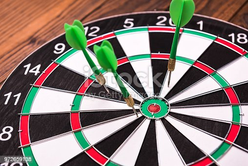 469652019 istock photo Darts missing the bulls eye 972659138