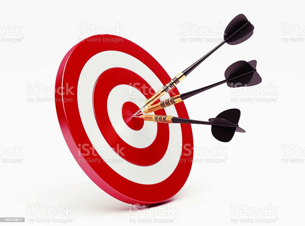 Darts on red target stock photo