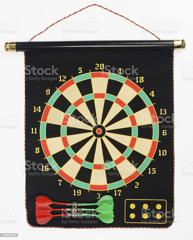 Darts set on a black sheet board royalty-free stock photo