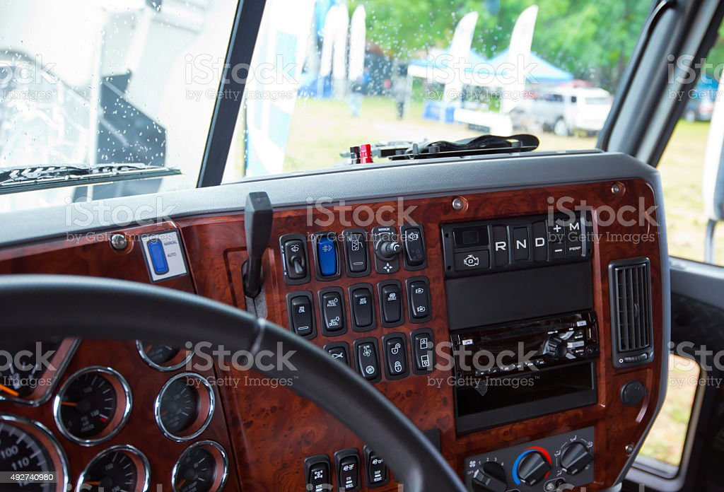 Dashboard console in interior of modern truck inlaid wood stock photo