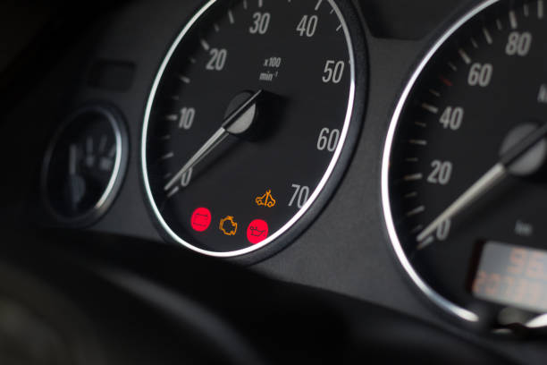 Dashboard indicators of usual car. Selective focus on tachometer. Dashboard indicators of usual car. Selective focus on tachometer. Service icons indicate to check engine, battery, oil pressure and maintenance distance. Arrows at zero.  Close up. Dark black design. dashboard vehicle part stock pictures, royalty-free photos & images