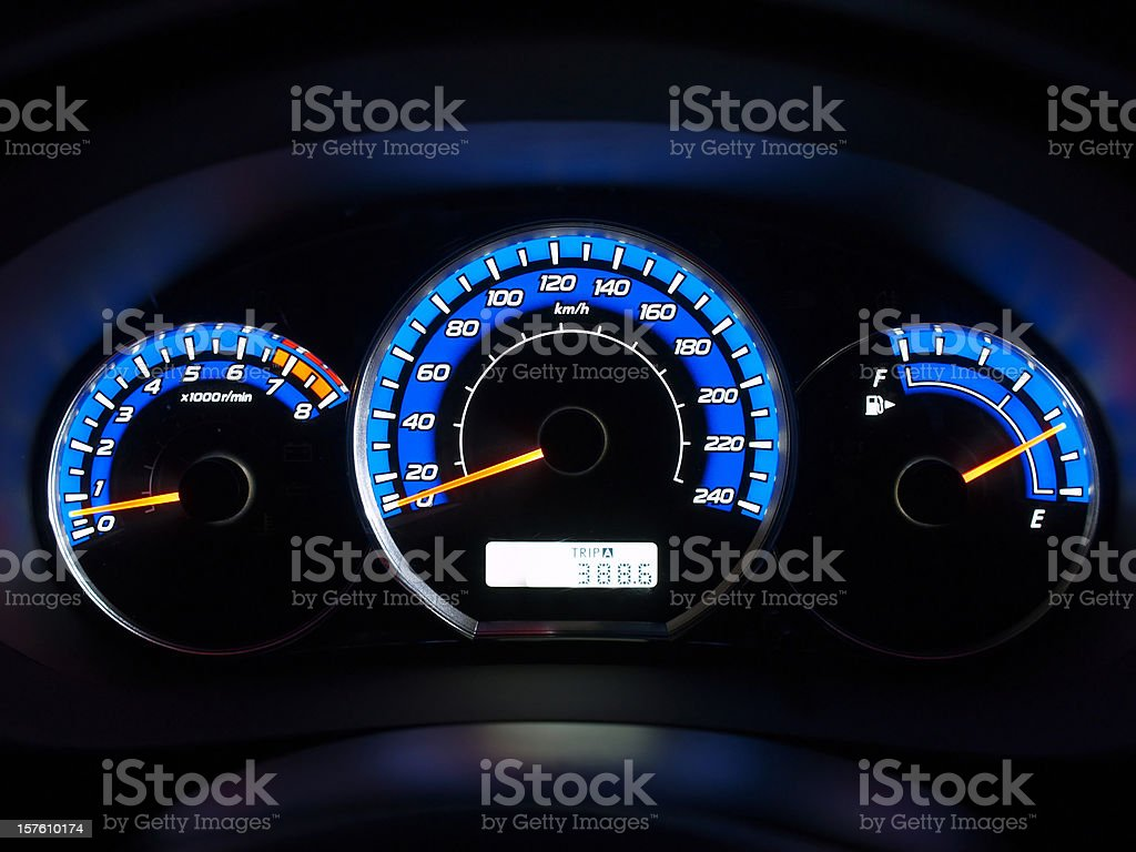 Dashboard lit up in blue at night royalty-free stock photo