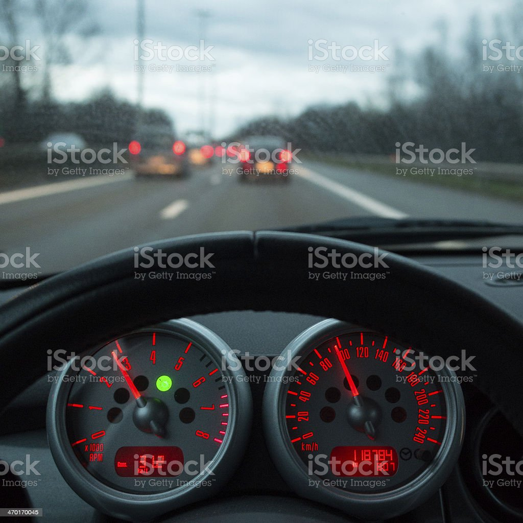 Dashboard of a car while driving stock photo