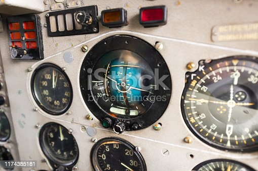 Dashboard of an old airplane. The main aircraft pointer, artificial horizon.