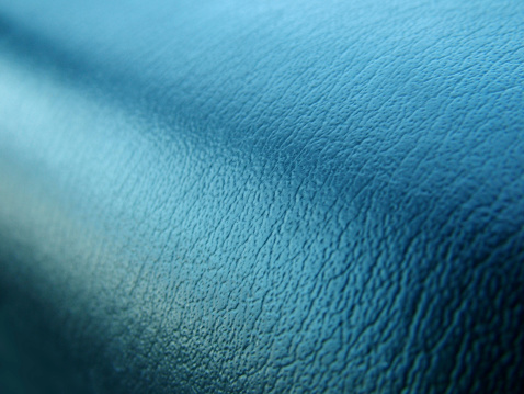 A close-up photo of a car dashboard. Has some really great lighting and texture to it.
