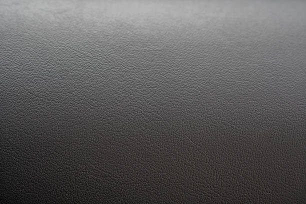 Dashboard surface of a car. Leather texture. stock photo
