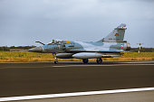 Schleswig - Jagel, Germany - June 19, 2014: French Air Force Dassault Mirage 2000 board number118-EZ is taxiing on strip of airbase Schleswig - Jagel during NATO Tiger Meet 2014.