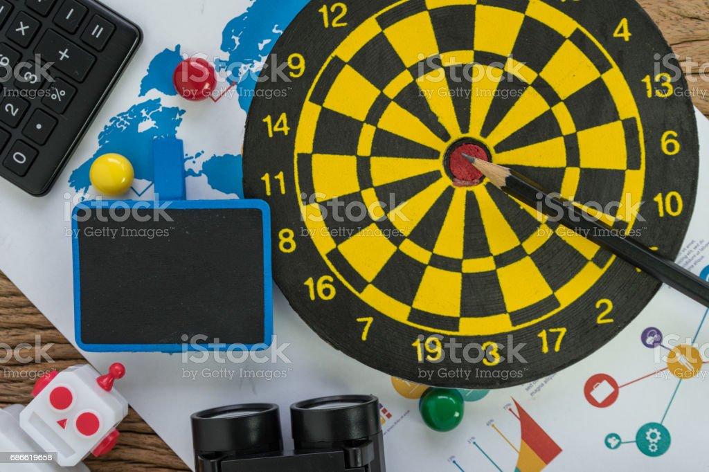 Data analysis SEO concept with pencil, dartboard, web analytics graph, calculator and binoculars on wood table stock photo