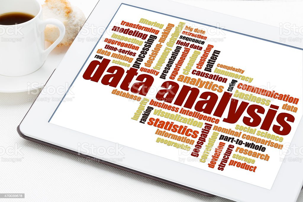 data analysis word cloud on tablet stock photo