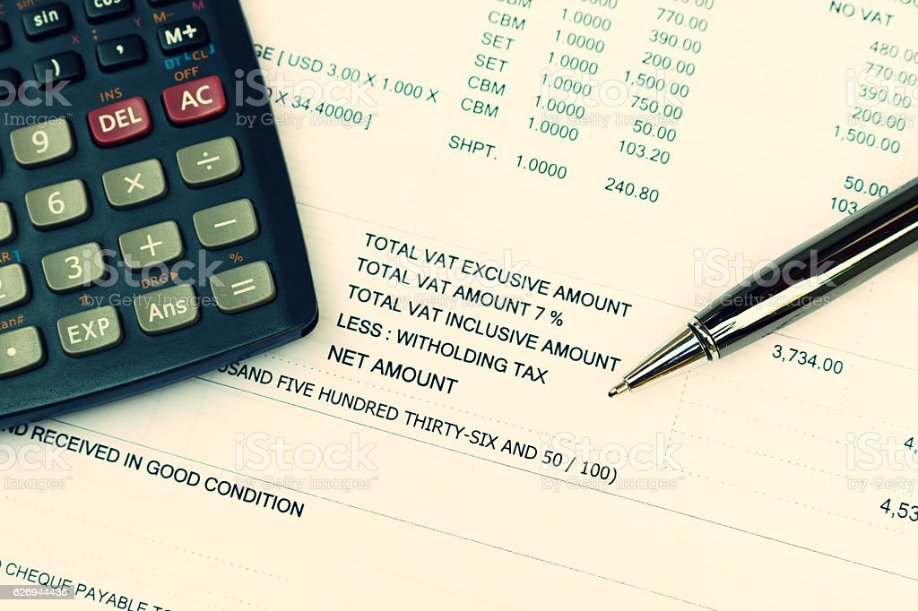 Data analyzing and tax with calculator and pen. stock photo