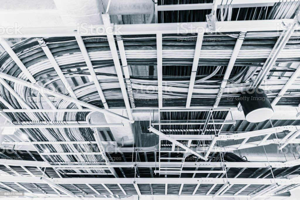 data and electrical communication cables in a cableway on the roof stock photo