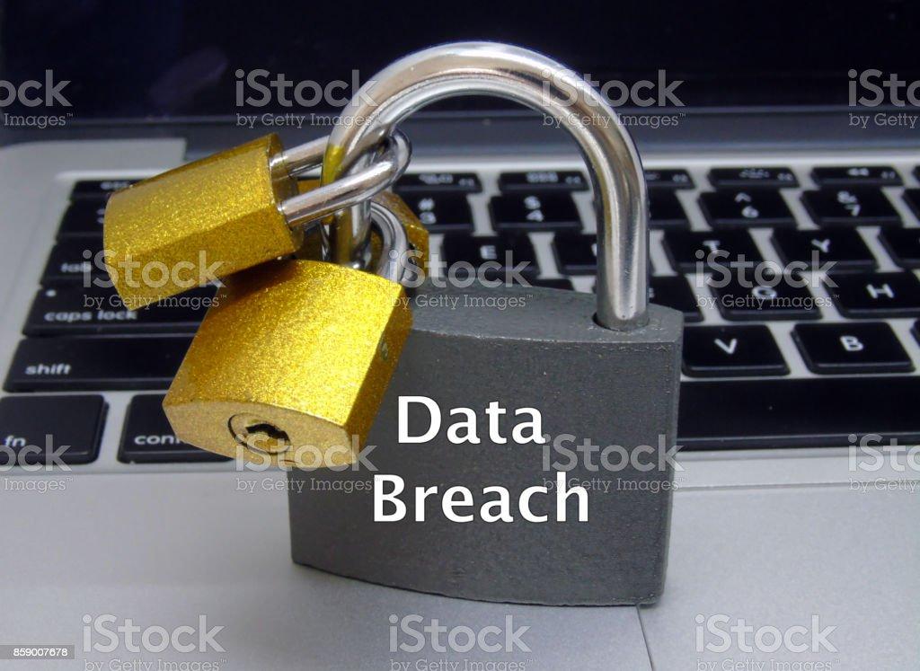'Data Breach' Padlocks on Laptop Keyboard stock photo