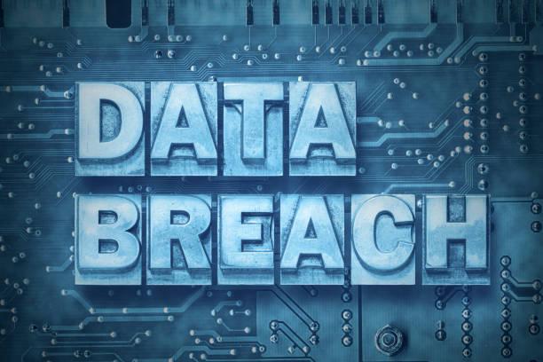 data breach pc board stock photo