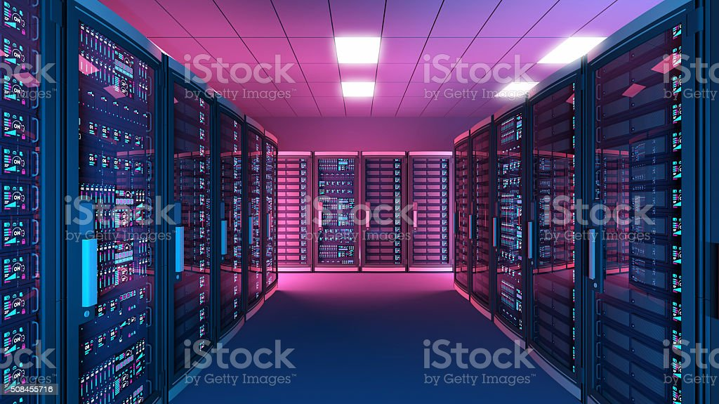 Data center with rows of network servers, dark with lights stock photo