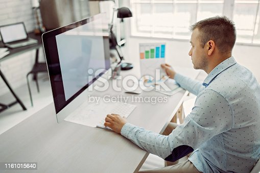 1053499704 istock photo Data has to be perfect on both, computer and paper 1161015640