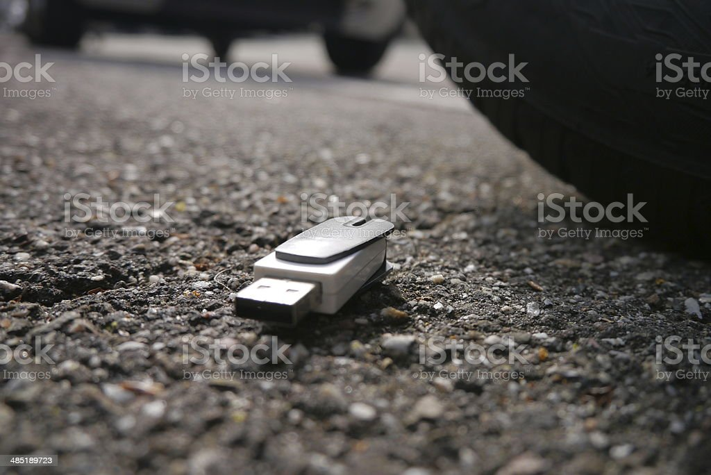 data loss, data breach. usb dropped on street stock photo