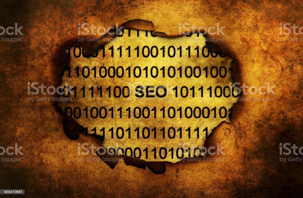 SEO data on paper hole stock photo