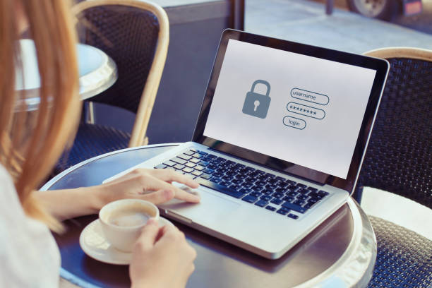 data protection and internet security concept, woman user typing password stock photo