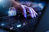 istock Data protection and secure online payments. Cyber internet security technologies and data encryption . Closeup view of man`s hand using laptop with virtual digital screen with icon of lock on it. 1227400166