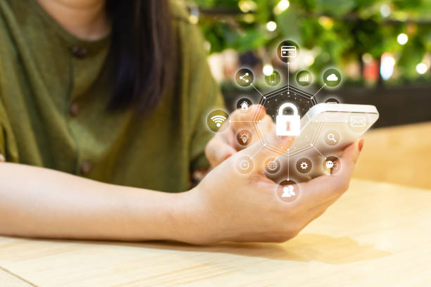 Data protection and security important information in your mobile phone, Woman hand using smartphone and icon key on shield Data protection and security important information in your mobile phone, Woman hand using smartphone and icon key on shield identity theft stock pictures, royalty-free photos & images
