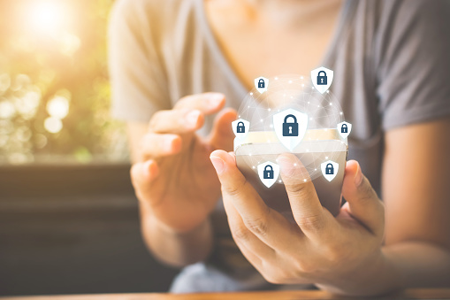Data Protection And Security Important Information In Your Mobile Phone Woman Hand Using Smartphone And Icon Key On Shield Stock Photo - Download Image Now