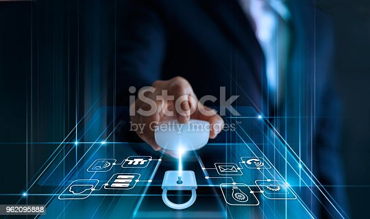 istock Data protection concept. GDPR. EU. Cyber security. Business man using mouse computer with padlock icon and internet technology network on blue background. 962095888