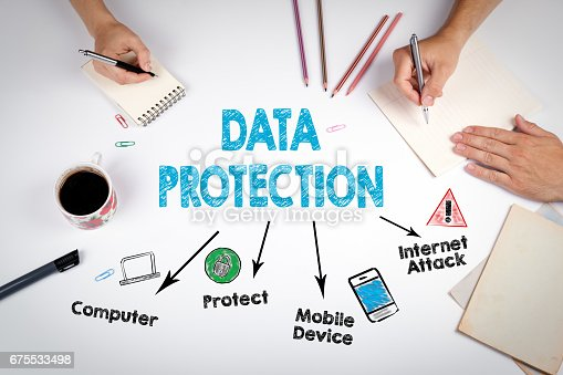 istock Data Protection Concept. The meeting at the white office table 675533498