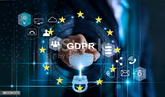 istock Data protection privacy concept. GDPR. EU. Cyber security. Business man using mouse computer with padlock icon and internet technology network on blue background. 962094370