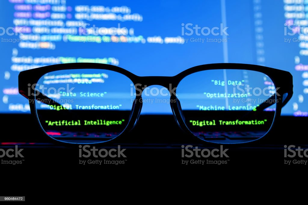 Data scientist , big data , artificial intelligence , machine learning technology concept. Silhouette glasses in front of laptop computer screen with programming coded. stock photo