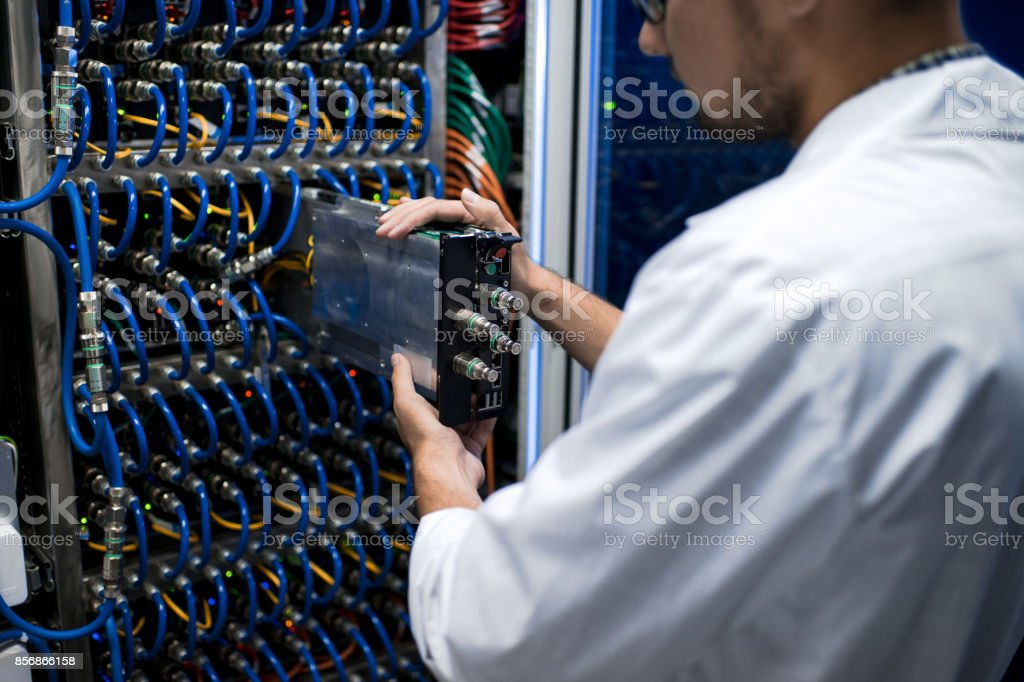 Data Scientist Working with Supercomputer stock photo