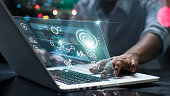 istock Data scientists. Male programmer using laptop analyzing and developing in various information on futuristic virtual interface screen. Algorithm. marketing and deep learning of artificial intelligence 1295900106