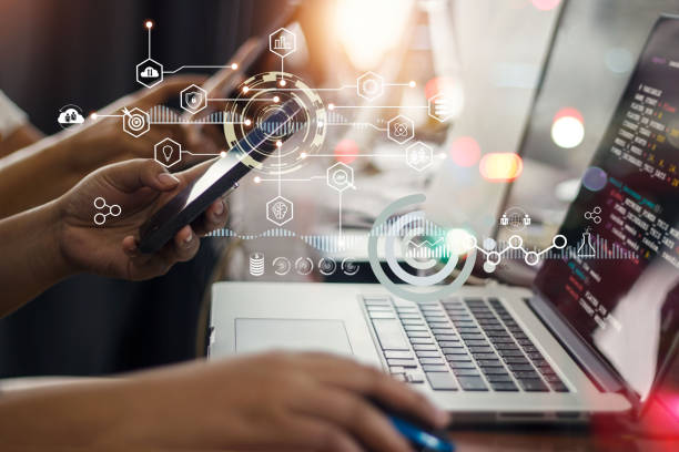Data scientists. Programmer team using laptop analyzing and developing in various information on futuristic virtual interface. Algorithm. Marketing and deep learning of artificial intelligence. stock photo