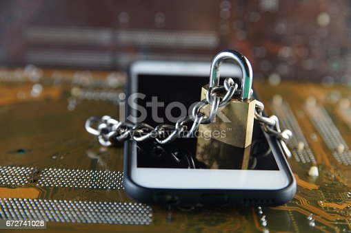 istock Data Security Encryption Protection Concept with Metallic Padlock chained over smartphone on electronic circuit board background. 672741028