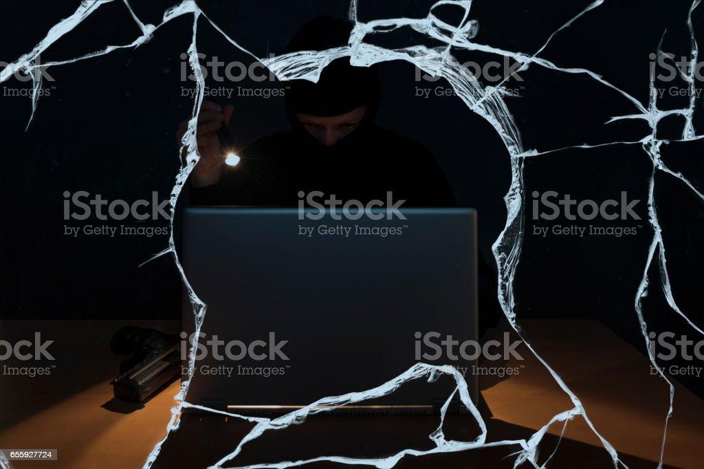 data thief hacking a computer stock photo