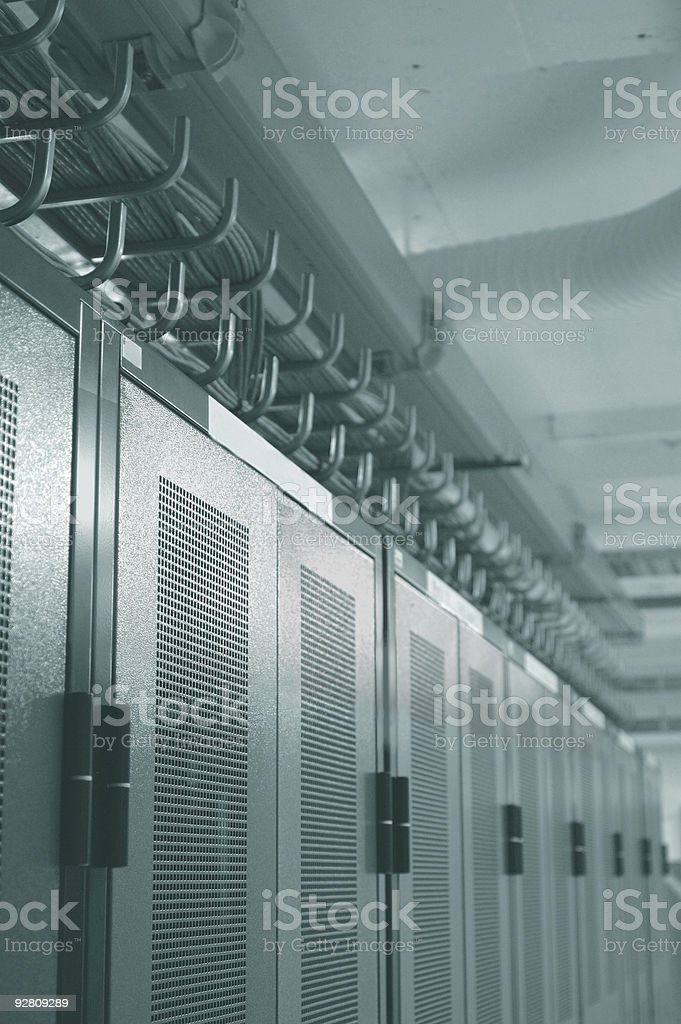Datacenter racks and overhead cable management stock photo