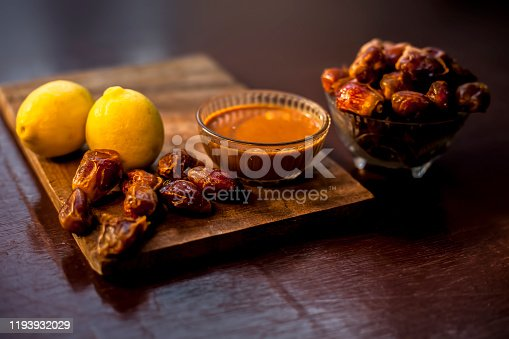 Date fruit face mask in a glass bowl consisting of some dates and lemon juice for oily skin. The horizontal well creative lit upshot of Date face mask for oily skin or Seborrhoea or seborrhea.