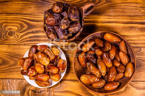 982465812 istock photo Date fruits on a wooden table. Top view 1020763838
