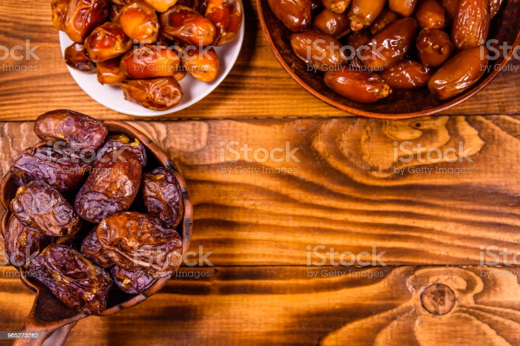 Date fruits on a wooden table. Top view royalty-free stock photo