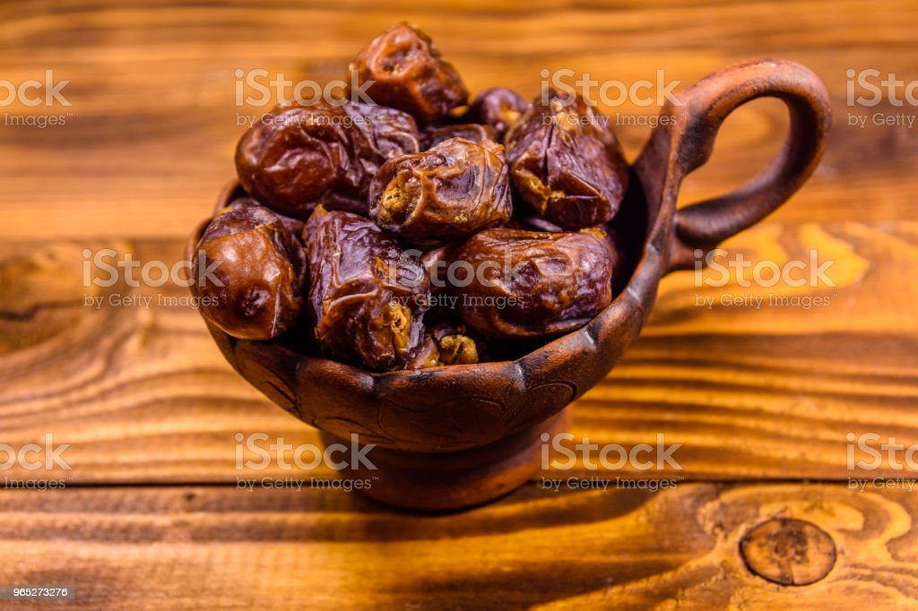Date fruits on the rustic wooden table zbiór zdjęć royalty-free