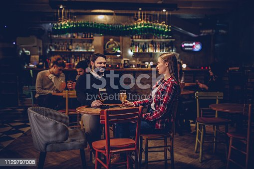 Happy couple drinking beer on a date night